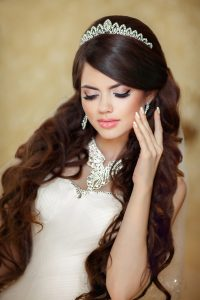 Portrait of beautiful brunette bride with long wavy hair styling